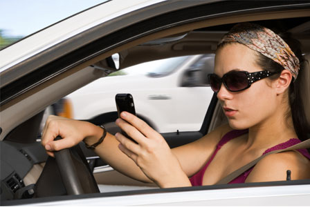 young-woman-driving-and-texting